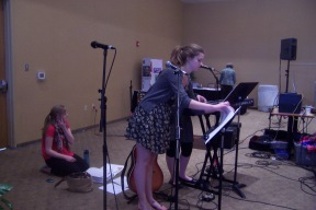 The worship team prepares for the event.